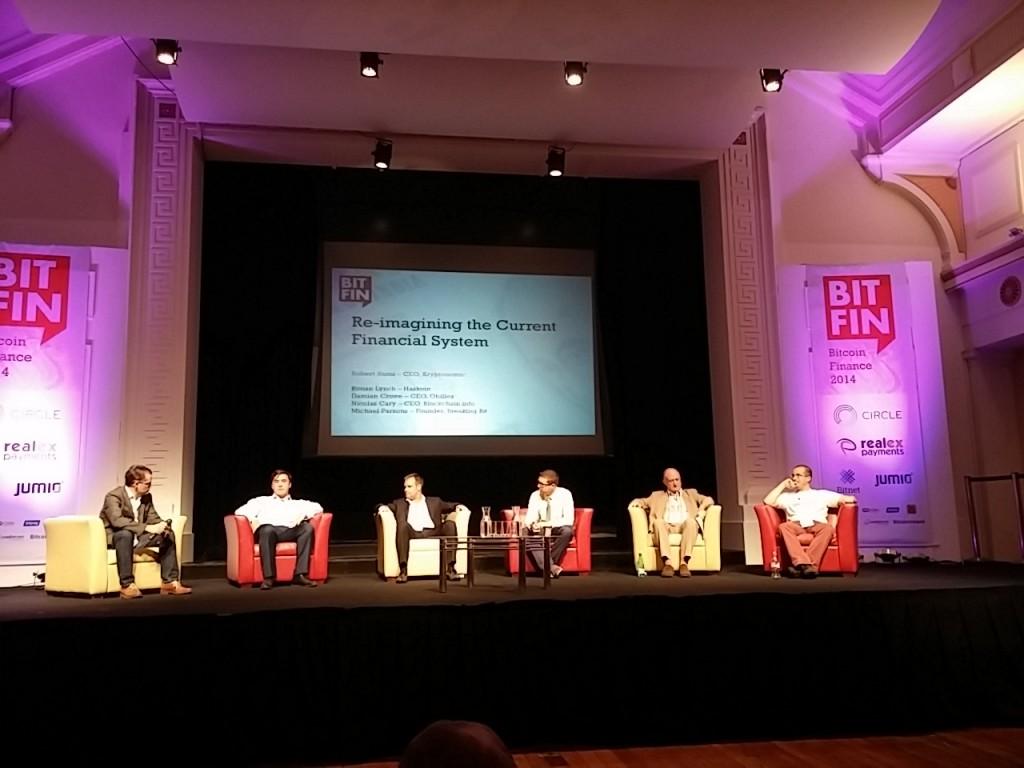 Robert Sams of Cryptonomics moderates a panel including experts Ronan Lynch, Damian Crowe, Nicolas Carey, Michael Parsons, and Simon Dixon